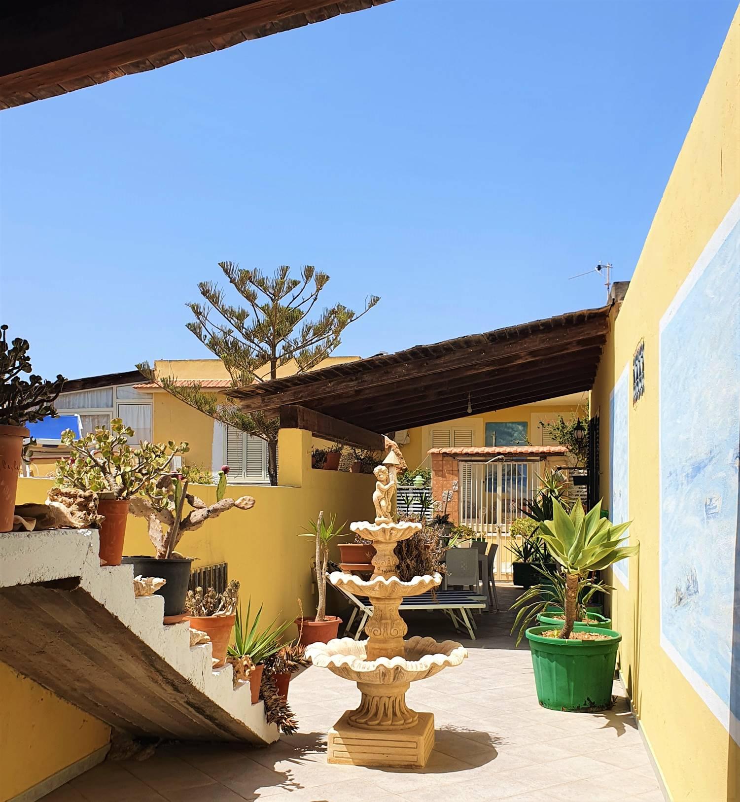 Residence La Porta del Cuore + Noleggio Scooter + Gita in Barca